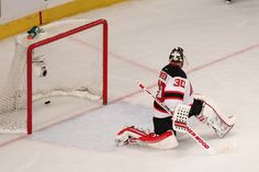 New Jersey Goalie Martin Brodeur begins to look over his shoulder as the puck goes into the net.