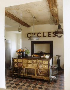 Industrial Rustic Kitchen, exposed beams, re-purposed island and rusty decor... what more could you ask for except maybe a little color...