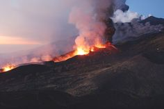 Short, violent bursts Credit: Marco Di Lauro/Stringer/Getty Mount Etna was described in The Aeneid, a Latin epic poem written by the Roman poet Virgil. The volcano has a longer written record of eruptions than any other volcano on Earth. Etna Volcano, Erupting Volcano, Lava Flow, Active Volcano, Sicily, Cool Photos, Amazing Photos, Mount Everest, Volcanoes