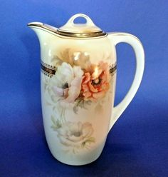White With White And Orange Poppies. Hand Painted Teapot Or Chocolate Pot. And Gold Gilded Borders And Accents. Made In Germany. Chocolate Pots, Chocolate Coffee, Orange Poppy, Gold Gilding, Gold Accents, Teapot, Poppies, Germany, Porcelain