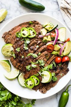 A delicious Carne Asada recipe made from marinated flank or skirt steak and cooked on the grill. Juicy, tender and a great addition to any Mexican meal! Carne Asada, Mexican Food Recipes, Beef Recipes, Dinner Recipes, Cooking Recipes, Dinner Ideas, Mexican Entrees, Mexican Tacos, Spanish Recipes