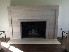 Beautiful Fireplace surround. Simple, yet such a statement piece. Clean lines!