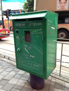 A green and purple Hong Kong post box from Nathan Road.