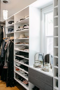 walk-in closet with milk glass pendant lamp. / sfgirlbybay