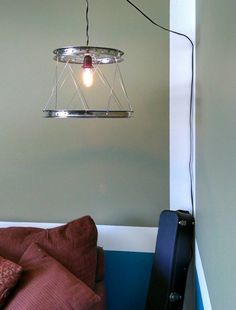 Pendant Light with Recycled Bicycle Wheel Shade, made by Class 5 Recyclery