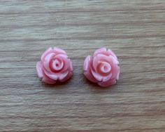 A personal favourite from my Etsy shop https://www.etsy.com/au/listing/247773483/rose-carved-flower-earrings-light-pink