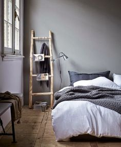 grey bedroom wall. Via la cool & chic