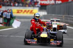 Red Bull's Mark Webber gives Ferrari's Fernando Alonso a lift back to parc ferme at the Nurburgring, Germany