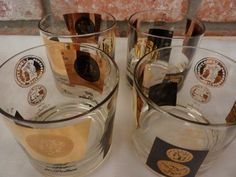 Set of 4 Libbey Coin Glasses Black and Gold With A Matching Ice Bucket.