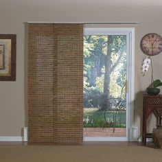 You'll love letting the sunshine in through patio doors and wide windows with this innovative 88 in. wide x 84 in. long x 2 in. deep Pecan Java Bamboo Panel Track Sliding  Shade.  Panel track shades are a stylish alternative to vertical blinds.