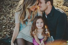 The focus on the child with the parents framing the photo is a great family photo!