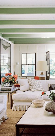 In Jacqueline Sackler's Amagansett home, interior designer Jacques Grange chose a trim color for the interior that mimicked the lichen on a tree in the garden; in the living room, that beautiful green hue stands out against the creamy slipcovered furniture and white walls. Inspiring Interiors | Buyer Select