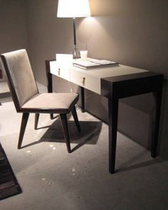 Calvin  does it again with this tailored desk with leather pulls. It's so sophisticated and just the right size.   - ELLEDecor.com