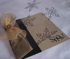 handmade card ... lovely snow card in brwon and black ... luv the cover of clear actetate with black embossed snowflakes ...