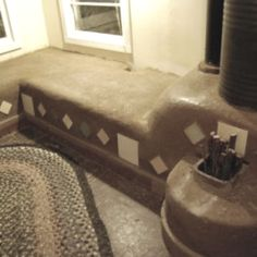 Rocket stove design plus running exhaust through seat- cool design