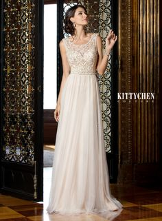 Cassidy gown by Kitty Chen, here at Poffie Girls! This stunning dress has a draped beaded back piece that is sure to sparkle on your big day!