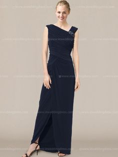 Affordable mother of the bride dress features an asymmetrical neckline, and a long, wrap-style skirt. Strategic pleating extends throughout the dress, working to flatter the figure. Available in 60 colors. Show in Navy.