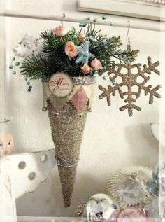 Silver sparkling cone. I suggest using a cold melt glue gun to make the cone, then just glitter and fill - pretty EZ and very pretty