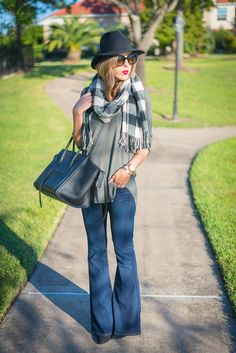 olive tunic, black and white buffalo plaid scarf, flare jeans