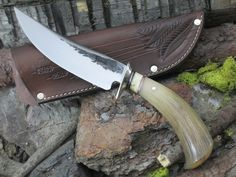 """3 1/2"""" Skinner knife, hand forged from Studebaker Steel. The guard is copper and sits above copper and black micarta spacers with a musk ox spacer to compliment. The handle is a Musk Ox Tine piece that measures the knife overall at 8 3/8"""" and comes in a Mosher Pouch Sheath. Handmade & Handforged in USA."""