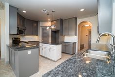 sub White countertops, different pendant lighting and wood island top
