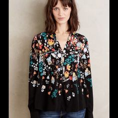 """Conversationalist Buttondown by Maeve A chatty pattern is an ace companion to winter's solid-hued sweaters. From the structured-yet-delicate collection of Maeve.   Rayon Patch pockets Button front Machine wash Imported Style No. 4110265301000 Dimensions Regular: 26.5""""L Anthropologie Tops"""