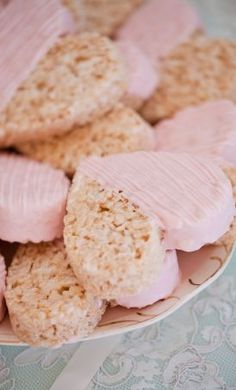 Heart shaped rice crispie treats dipped in pink white chocolate. Inspired by This Pink Vintage Tea Party Bridal Shower by Chris & Kristen Photography — Loverly Weddings