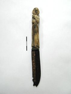 Antropomorfic knife, ivory (?), iron and copper incrustation, found in Szczecin / second half of the 13th c. (Northern Poland), National Museum in Szczecin