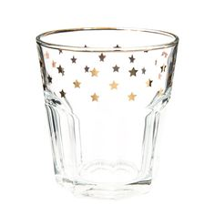 A nod to the gold interiors look with golden star print on glasses | Water tumbler with gold star motif | Maisons du Monde