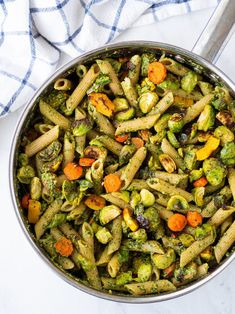 This vegan pesto pasta is made with penne tossed with an easy dairy free basil pesto sauce and roasted fall vegetables, like delicata squash and Brussels sprouts!  #rachaelhartleynutrition #thejoyofeating #vegan #veganrecipes #pesto #veganpesto #pestopastarecipes #pestorecipes #vegetarianpastarecipes #brusselssprouts #delicatasquash