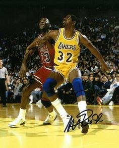 Magic Johnson signed Los Angeles Lakers 8x10 Photo (yellow jersey block out rebound vertical vs Michael Jordan- black sig)