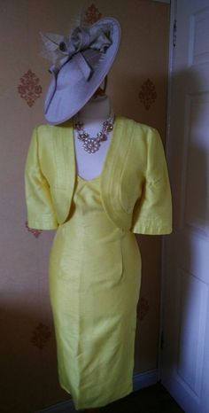 "STUNNING DRESS AND BOLERO JACKET BY MICHAELA LOUISA SIZE 12    BRAND NEW WITH TAGS COST £195    MATERIAL IS 67 % VISCOSE  33% POLYESTER    MEASUREMENTS   DRESS BUST 36""  WAIST 32""  HIPS 41/42""  LENGTH 42""    JACKET  ACROSS TOP OF SHOULDERS 16 1/2""  PIT TO PIT 18 1/2  LENGTH 16""    NECKLACE FOR SALE IN MY OTHER LISTINGS    PLEASE HAVE A LOOK AT MY OTHER ITEMS FOR SALE  