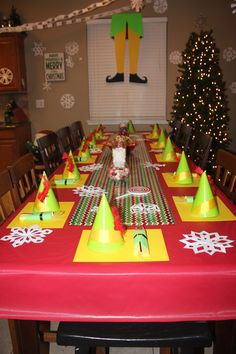 Buddy The Elf Christmas Party theme. Handmade elf hats for each guest and window decor made from poster board.