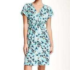 "Tommy Bahama Marina Garden Dress Mint + aqua blue with lovely florals, this is the ideal dress for a casual garden party. V-neck and elasticized waist with smocking detail. Length {37"".} True to size. Tommy Bahama Dresses"