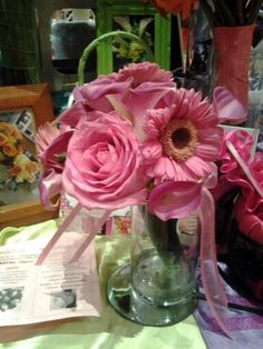 Pink roses pink calla lilies pink gerbera daisies with dark center wrapped in black satin for a bridesmaid