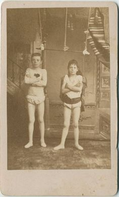 Soyouthinkyoucansee on tumblr- ca. 1880's, [portrait of two young circus performers in the artist's studio], M. W. Newcomb    via the KaufmaNelson Vintage Photography Gallery
