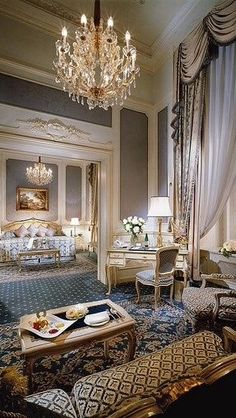 Stunning bedroom.  I love the desk and sitting area outside of the bedroom, chandeliers, high ceilings and elegant décor.  Could be an amazing hotel somewhere.