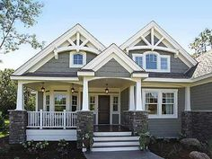 love stained front door, windows on either side, porch rail, siding style and color, trim, like how front porch has separate little 'jut out' roof that draws eye to front door