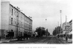 Street View at Fish Bros' Wagon Works; factory buildings are on the left. The view is looking west down State Street from Marquette Street.