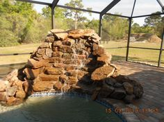 Rock Waterfall #7 | Uni-Scape Waterfalls, Natural Stone Work, Ponds, Swimming Pool and Spa Renovation, Flagstone Patios and Outdoor Kitchens.