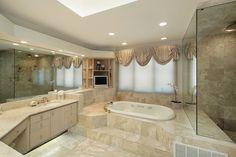 Luxury bathroom design in beige with large windows and a travertine floor #travertine #floor #bathroom #interior #naturalstone