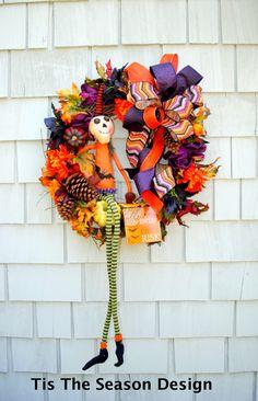 Halloween Wreath, Skeleton Wreath,  Black Orange Purple and White, Spooky Pumpkins, Hauunted Floral, Pine Cones by TisTheSeasonDesign on Etsy https://www.etsy.com/listing/279463818/halloween-wreath-skeleton-wreath-black