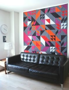 Decorating with quilts: this modern wall quilt goes all the way to the ceiling. Featured at Design Milk