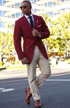 Men's Navy Knit Tie, White Dress Shirt, White Pocket Square, Red Plaid Blazer, Beige Dress Pants, and Brown Leather Brogues