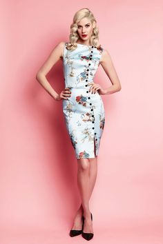<div>From the Wheels archive returns the famous Irma La Douce Dress, re-imagined in this season's delightful La Mayfair Affair print in duck-egg blue with hints of rouge and rose. This classic Hollywood inspired piece is sleek and sassy in our deluxe stretch matte imported satin. The printed satin features French antique florals and fauna in autumnal shades. Delicate peacocks perched upon ornamental filigree and delicate latticework are interwoven in this charming design. The…
