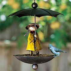 Keeping Bird seed dry. I believe this has already appeared on Pinterest. It's a bit  kitsch, but sweet enough to be a lovely addition in (my ) a garden! Someone commented that she looks like Madelaine!