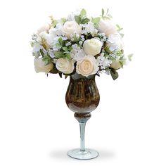 Arranjos de flores artificiais  Rosa na taça de vidro, flores em seda importada com corte a laser. É uma composição Sofisticada e romântica. Vamos decorar a casa,escritório e etc, com este lindo acessório decorativo ? O Arranjo artificial de flores mistas na taça de vidro  pode ser levado a mesa sem interferir no cheiro da comida.  Excelente para os alérgicos. Incontestável em durabilidade comparada a natural. Este projeto também fica lindo em uma mesa de festa.  O valor e as dimensoes são…