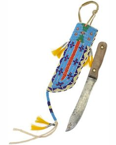 Sinew Sewn #Beaded Sheath & Wooden Handle #Knife.Featuring beautiful geometric designs on a light blue background, this knife sheath was made by the young Miss Ravenshead; she is the 15 year old daughter of quillwork artist Chris Ravenshead. #PrairieEdge