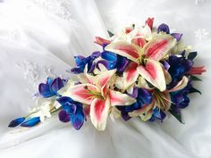 Stunning Natural Touch Blue Purple dendrobium orchids, Silk Ivory Orchids and True Touch Pink/White Stargazer Rubrum Lilies Cascade Wedding
