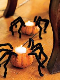 DIY Creepy Crawlers Candle Votives... Easy to do. Cut top centers of Miniature pumpkins & hollow out. Place tealight candles inside & light. Add pipe cleaners for the spider legs for Halloween OR you can do without the legs for to execute a simple Fall pumpkin votive... either way,very cute. :)
